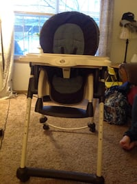 brown and black wooden high chair Lansing, 48911