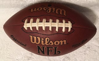 WILSON NFL football with signatures.
