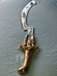 gold-colored dragon handle dagger