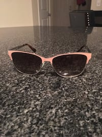 pink and black framed outdoorsman sunglasses