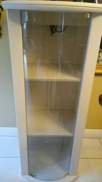 Precious moments cabinet.curved glass door...1 extra door.with 2 shelv
