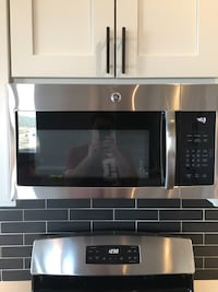 Brand new over the range microwave GE stainless steel 2 year warranty!!!