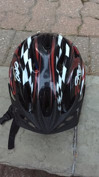 black, white, and red bicycle helmet Toronto, M3B 2W1
