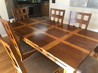 rectangular brown wooden table with chairs Jersey City, 07305