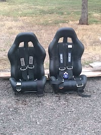 Driver and Passenger race seats. With Harness.