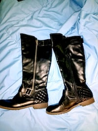 pair of black leather knee-high boots. Albuquerque, 87109