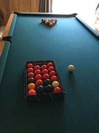Brunswick pool (brown and green) table