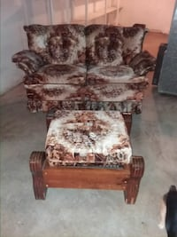 brown and white floral fabric sofa chair