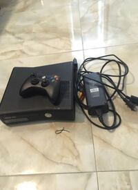 black Xbox 360 console with controller and game case