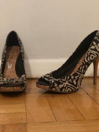 pair of black-and-brown platform stilettos 229 mi