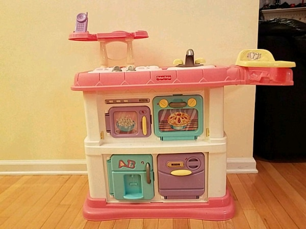 pink and white Little Tikes kitchen play set