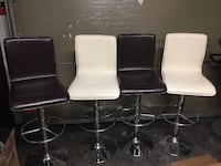 four brown and white leather swivel chairs 50$ each  MONTREAL