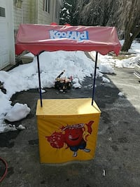 red and yellow Kool-Aid food stall