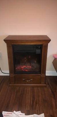 brown wooden framed electric fireplace Knoxville, 37909