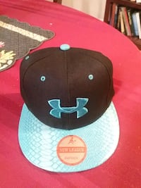 black and blue Under Armour fitted cap Ponce Inlet, 32127