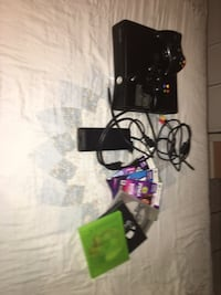 Xbox 360 with 6 games 2 controllers and all the wires  Visalia, 93277