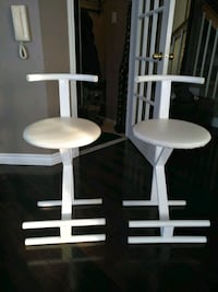 two white wooden bar stools