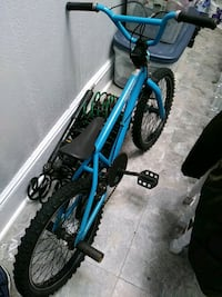 blue and black BMX bike 221 mi