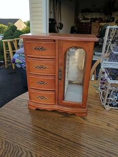 brown wooden jewelry cabinet
