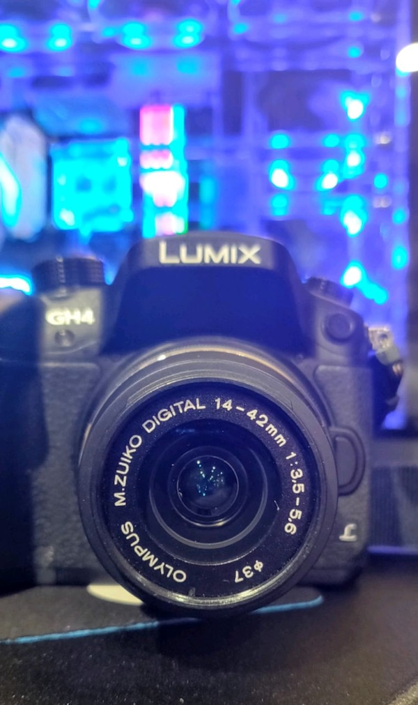 Panasonic Lumix GH4 with lens & 2 batteries & 2 ch