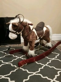 toddler's brown and white rocking horse