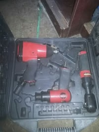 red and gray power tool