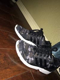 Pair of black-gray-and-white adidas camouflage low-top sneakers Temple, 76502