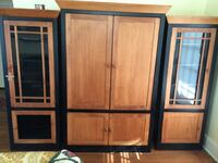 brown and black wooden TV hutch cabinet Mamaroneck, 10543