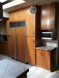 brown wooden cabinet with shelf Edmonton, T6C 0A4