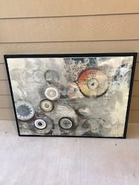 Canvas painting with black frame