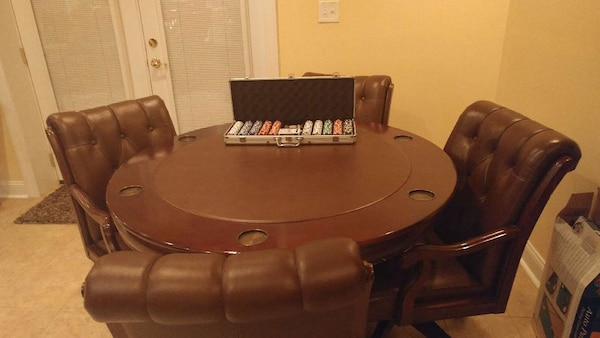 Poker table with 4 matching leather chairs