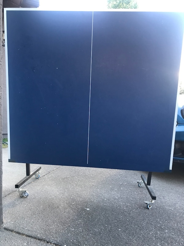 Ping Pong Table with net.   Works as is but could use some small repairs to make it great again