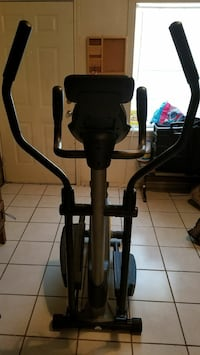 black and grey elliptical trainer