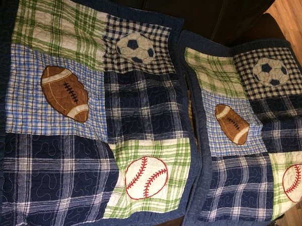 blue, green, and white plaid textile d23f8b5c-30df-4135-82bf-c16e9be3a9f3