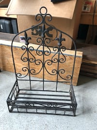 "Wrought iron it's about 14""L X 24""HX6""D"