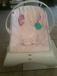 white Fisher Price bouncer