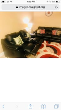 Black electric recliner couch and love seat