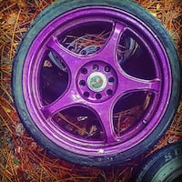 purple 5-spoke vehicle wheel and tire Gaston, 29053