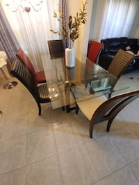 6 chairs and 1 glass table Houston, 77047