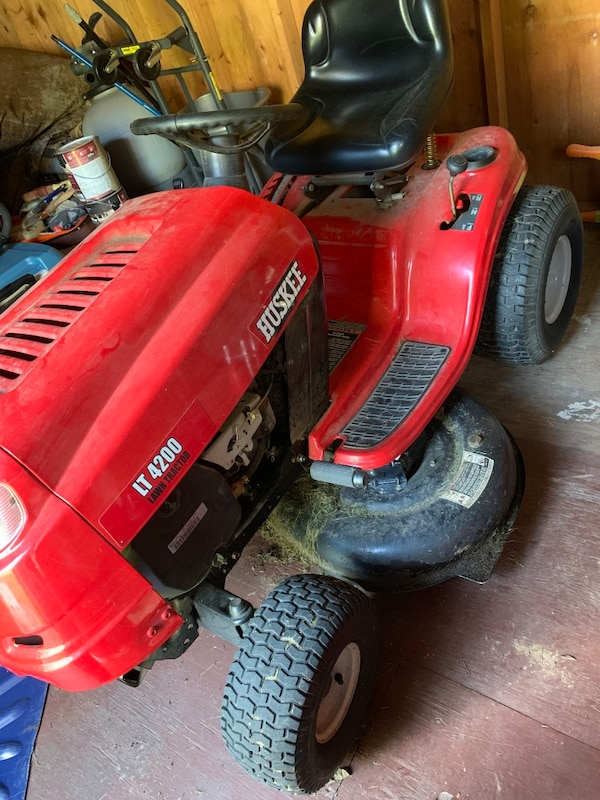 red and black Huskee ride on lawn mower