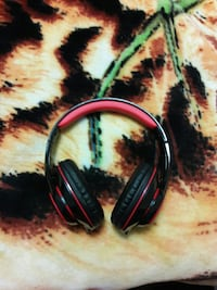 black and red cordless headphones