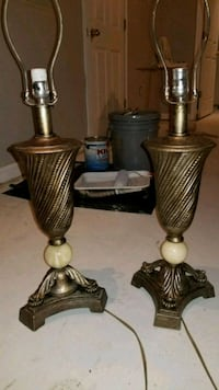 two brass-colored candle holders 20 mi