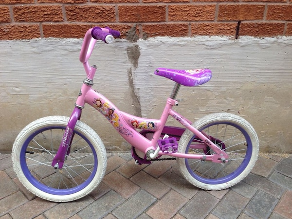 toddler's pink and purple bicycle