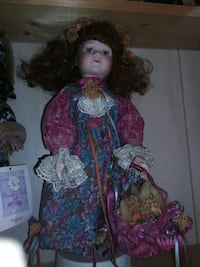 girl doll in pink and blue floral dress Dundalk, 21222