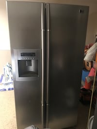 gray side-by-side refrigerator with dispenser