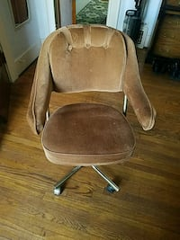 brown suede padded rolling armchair