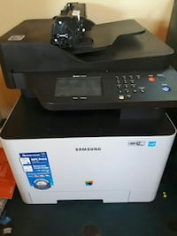 black and white Samsung multi-function printer 3507 km