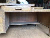 Old oak desk:3 side drawers, one center drawer, under desk shelf. 40 km