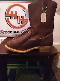 pair of brown leather cowboy boots Denver, 80202