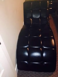 black leather tufted rolling chair